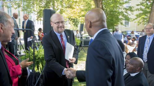 Chancellor Molloy shakes hands at Robeson Plaza Dedication Ceremony