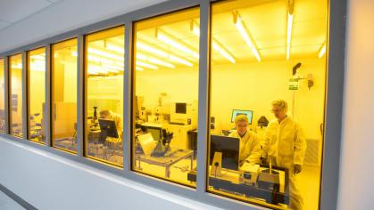 People work in a clean room for scientific research